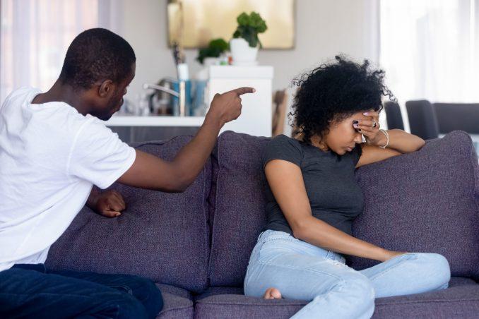 Angry African American man quarreling, shouting at upset woman
