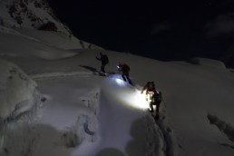 climbing icefall at night