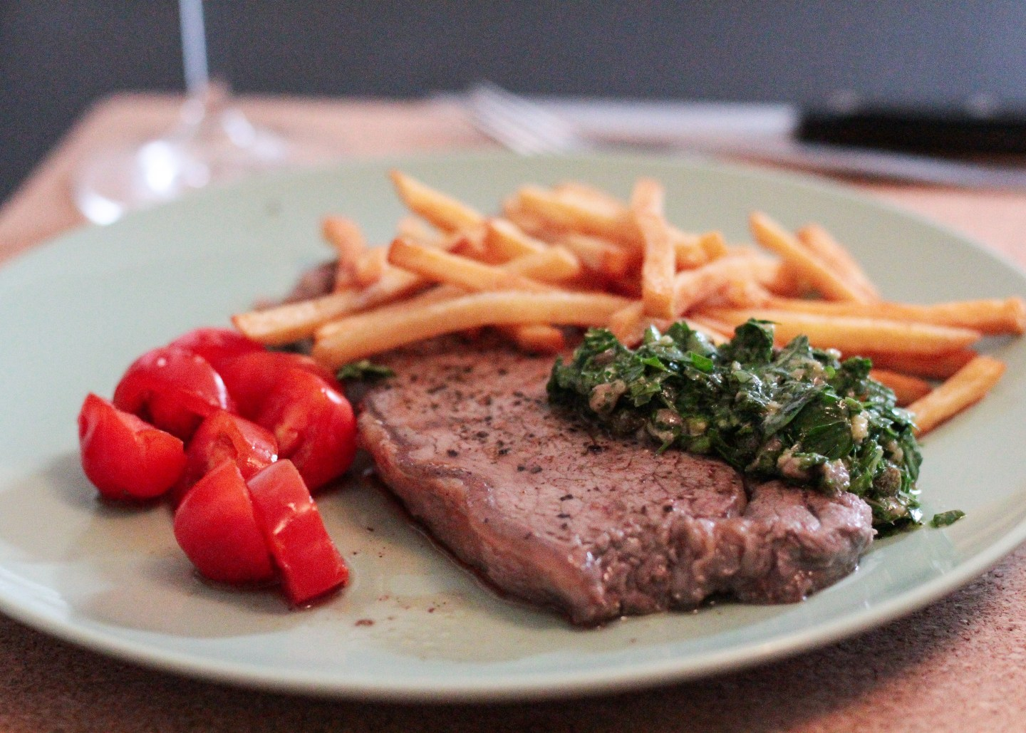 steak with salsa verde on the table