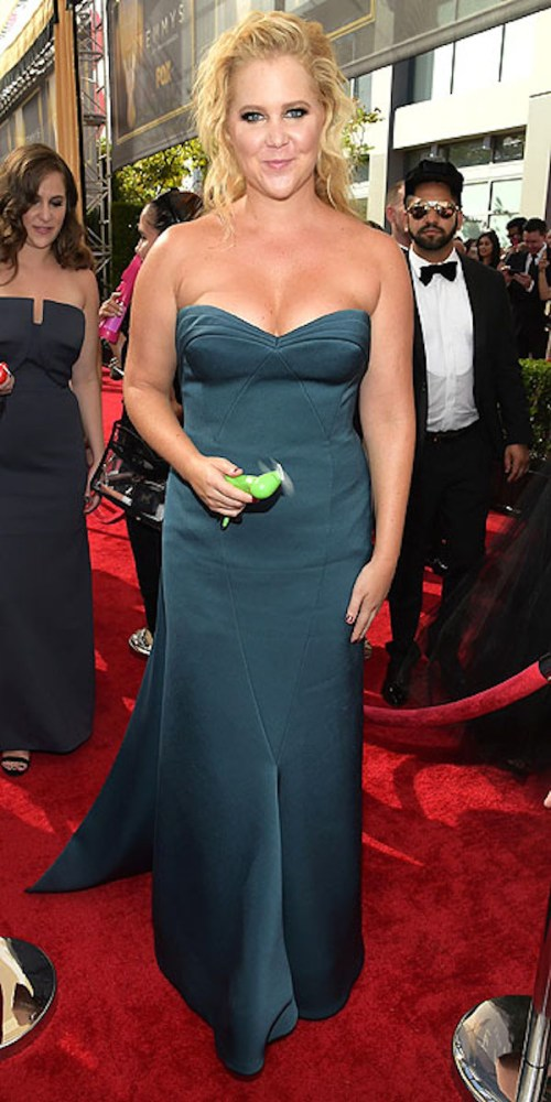 IMAGE DISTRIBUTED FOR THE TELEVISION ACADEMY - Amy Schumer arrives at the 67th Primetime Emmy Awards on Sunday, Sept. 20, 2015, at the Microsoft Theater in Los Angeles. (Photo by Charles Sykes/Invision for the Television Academy/AP Images)