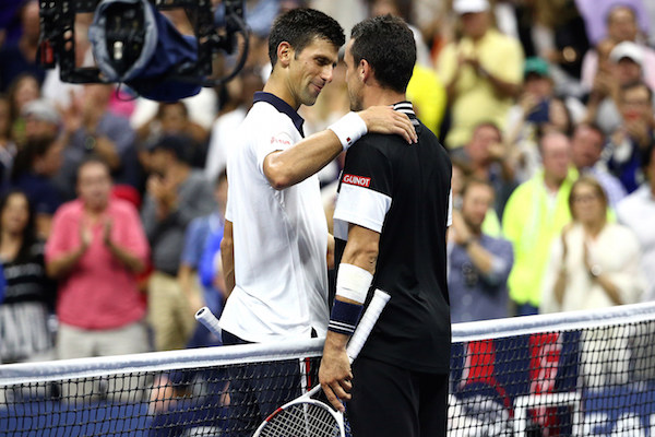September 6, 2015 - Novak Djokovic greets Roberto Bautista Agut at the net after a men's singles fourth-round match during the 2015 US Open at the USTA Billie Jean King National Tennis Center in Flushing, NY. (USTA/Ned Dishman)