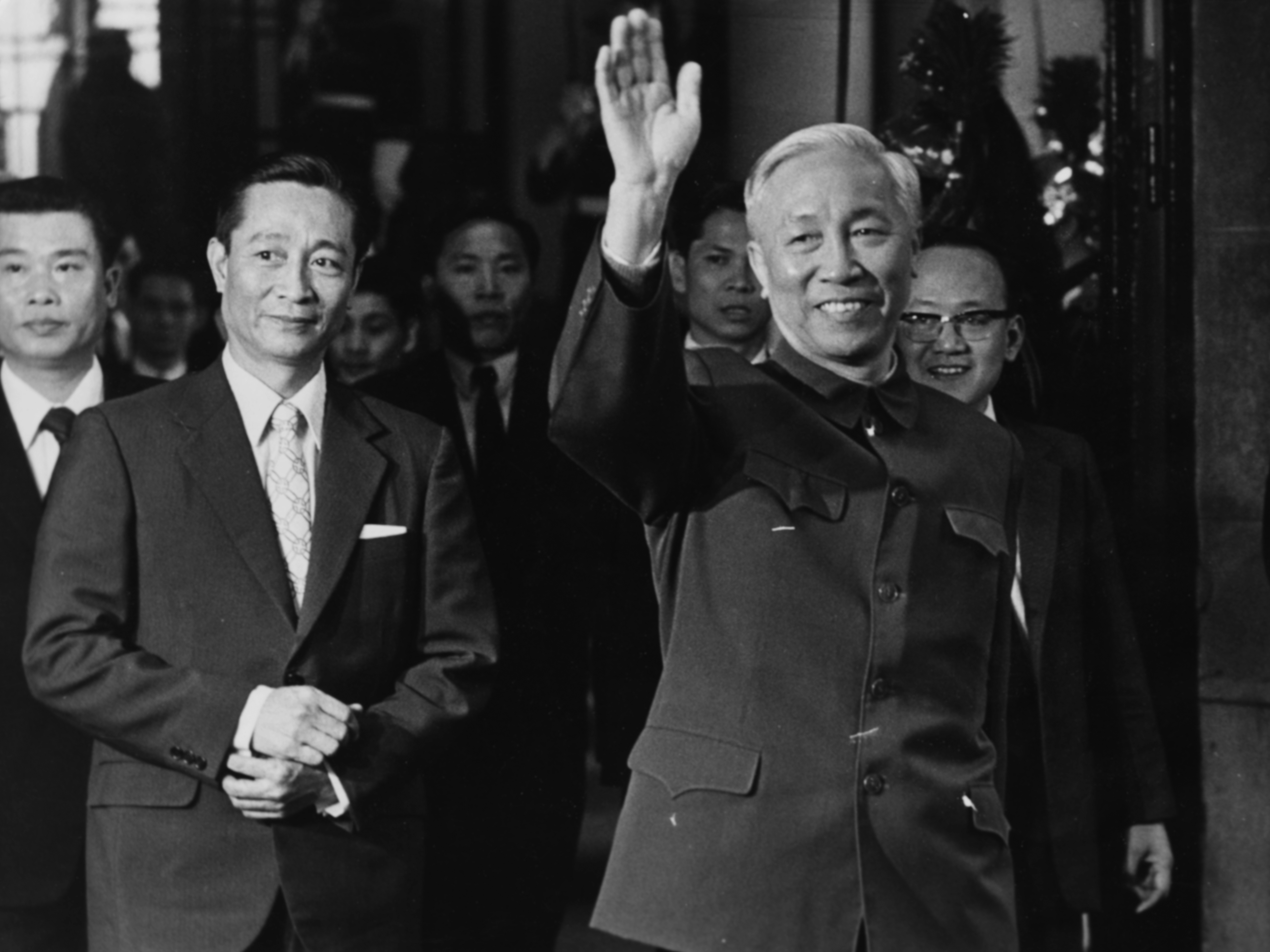 Vietnamese politician Le Duc Tho waving to photographers as he arrives at a conference in Paris, circa 1970. (Photo by Keystone/Hulton Archive/Getty Images)