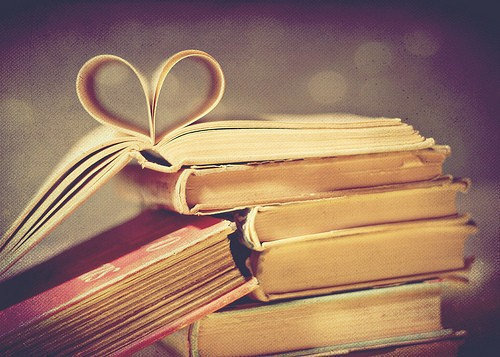 Books with pages folded in a heart