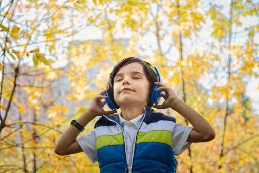 little boy listening the music