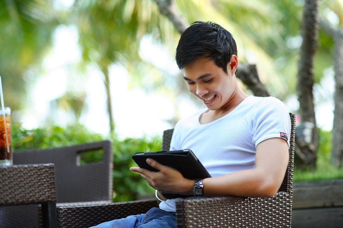 man searching on tablet for life insurance while young