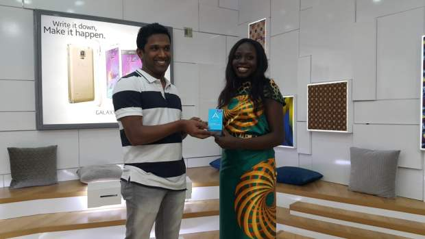 Lola Ichetaonye, winner of Samsung Galaxy A5 receives her prize from Product Manager - Mobile, Samsung Electronics West Africa