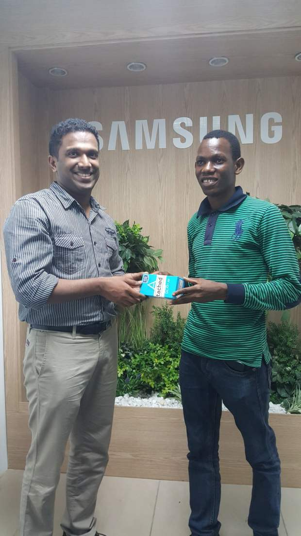 Jelili Bamidele (3rd Place Winner) receives his prize from Anish Mathew, Product Manager, Samsung Electronics West Africa (Mobile)