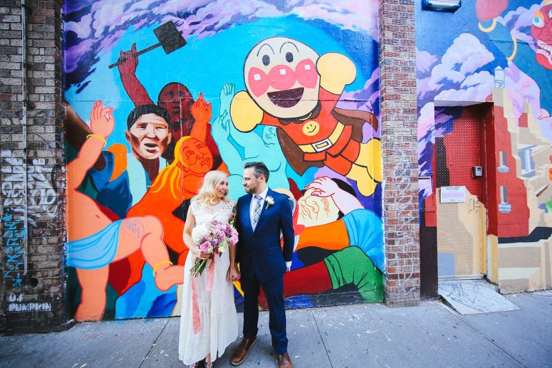 Bride and Groom Near Mural