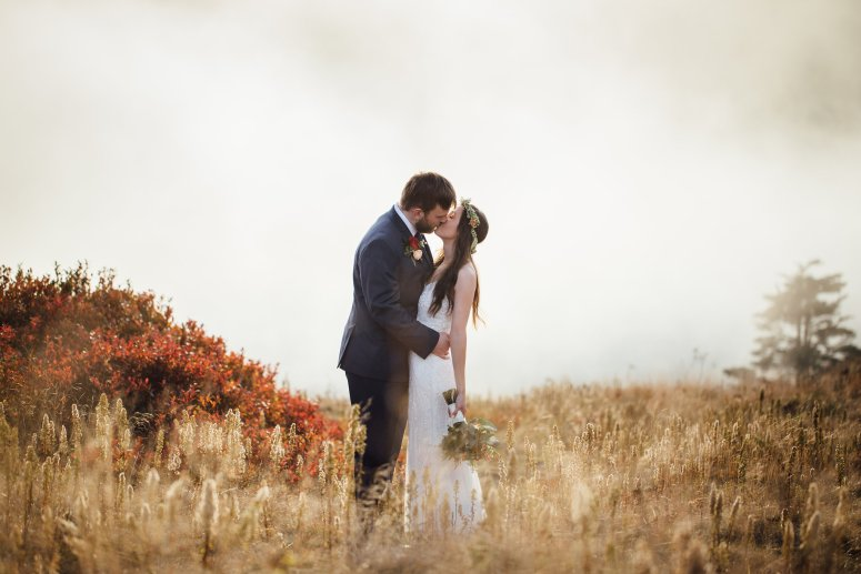 Bride and Groom in Wheat field kissing