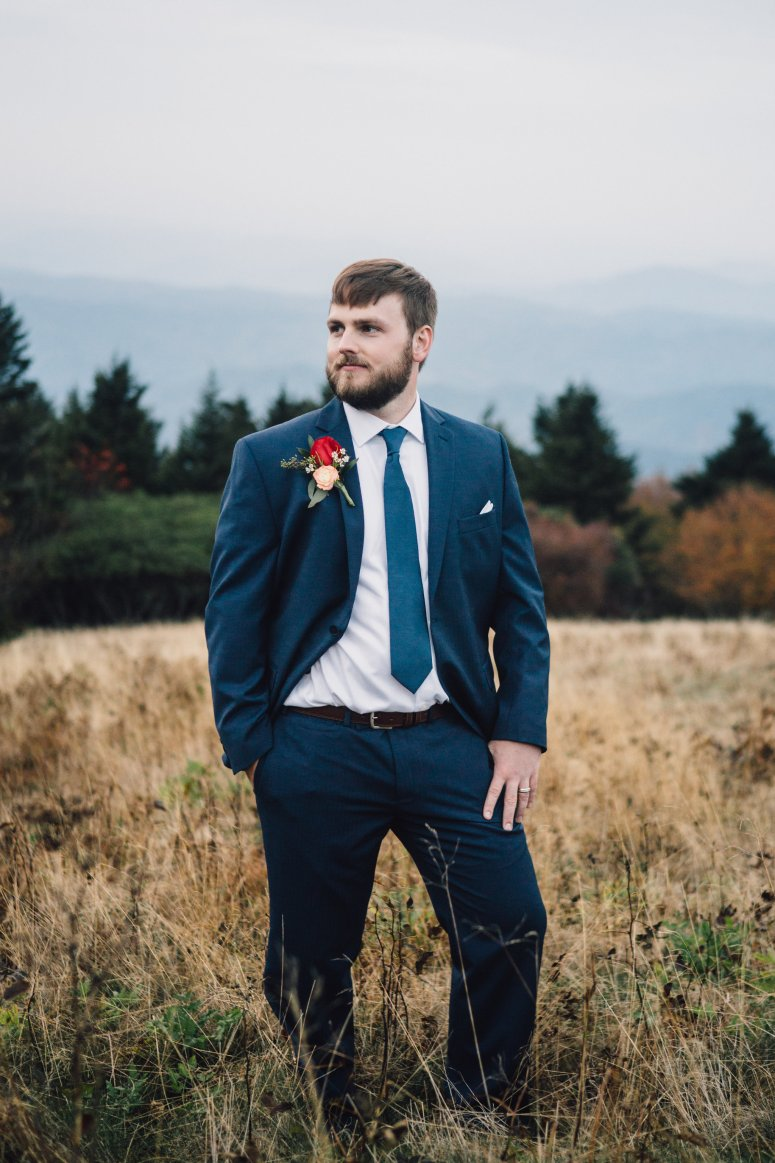 Groom in Navy Suite with Red Rose Boutonniere