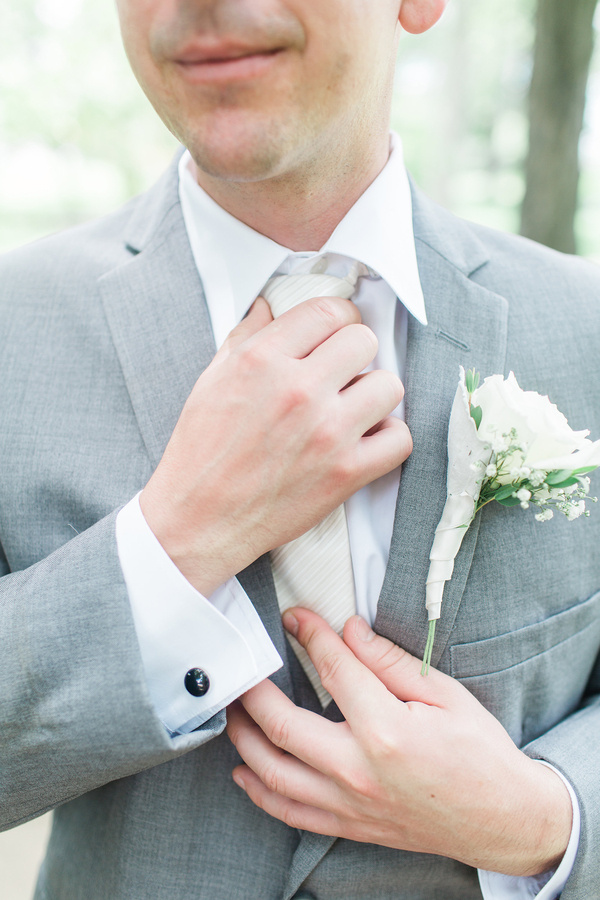 Groom in gray tux with cream tie
