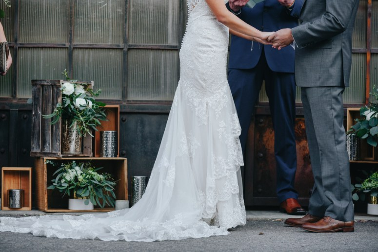 Bride and Groom Saying Vows at Rustic Chic Wedding