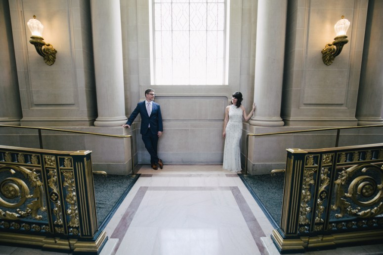 Bride and Groom posing for wedding portraits in City Hall