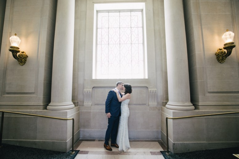 Bride and Groom Kissing in City Hall
