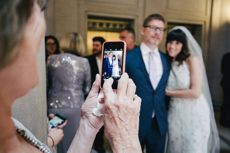 Guests Taking iPhone Pictures at a Wedding