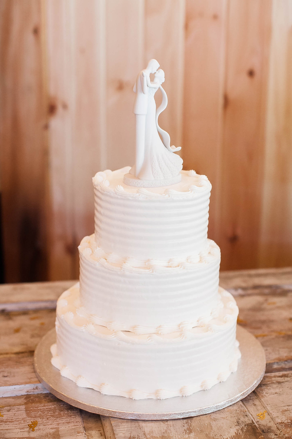 Three tier all white minimal wedding cake