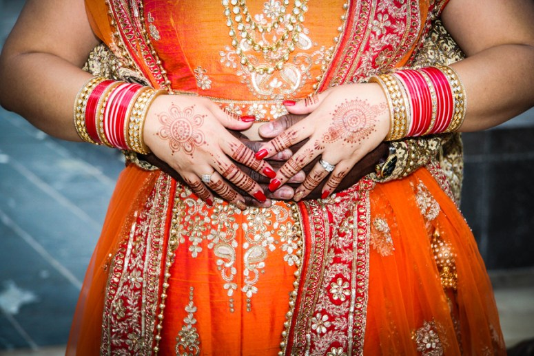 south asian wedding bride and groom holding hands