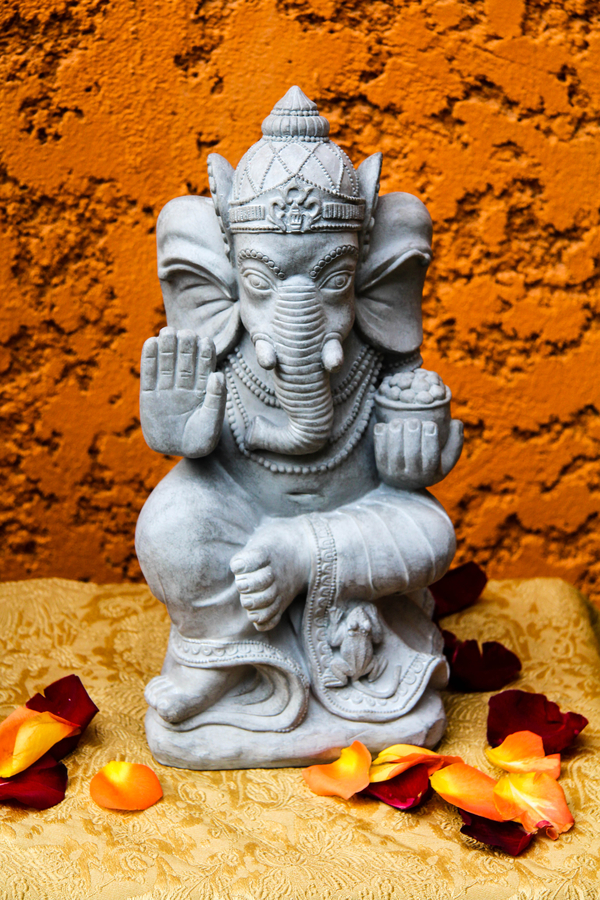 Ganesha statue with rose petals
