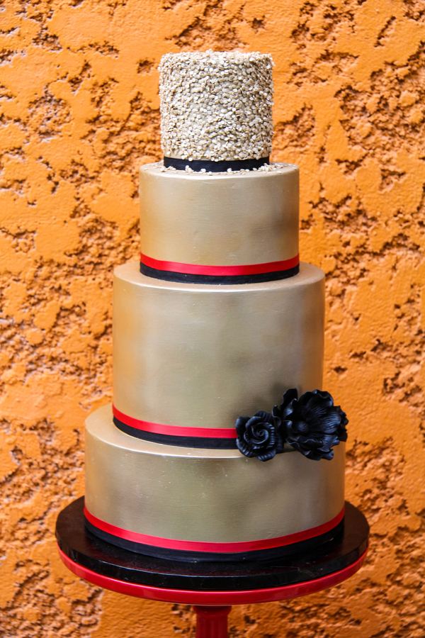 red black and gold wedding cake