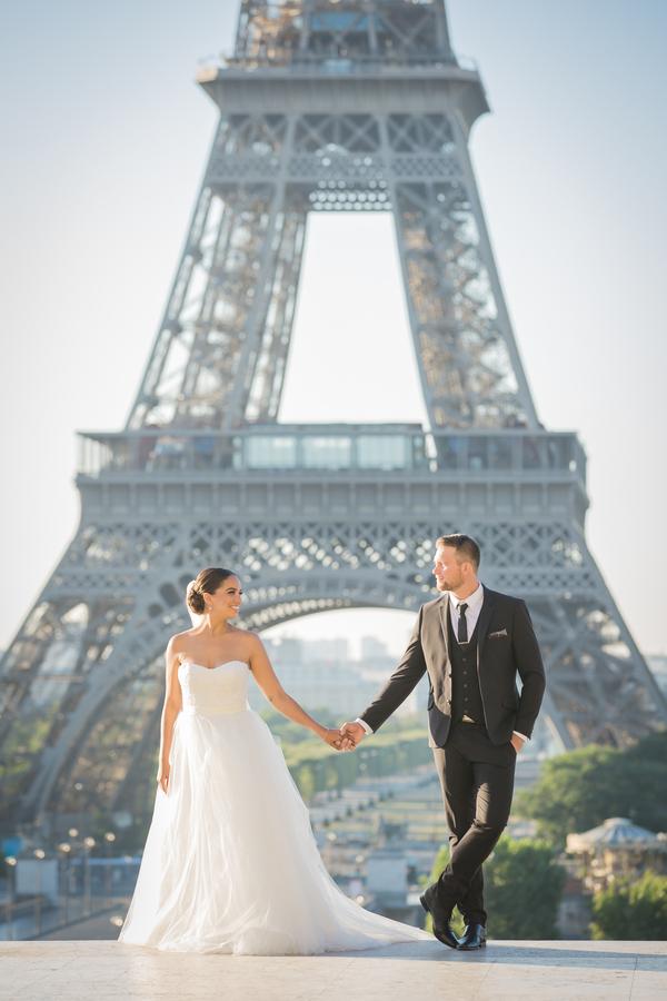 Bride and Groom Under Eiffel Tower