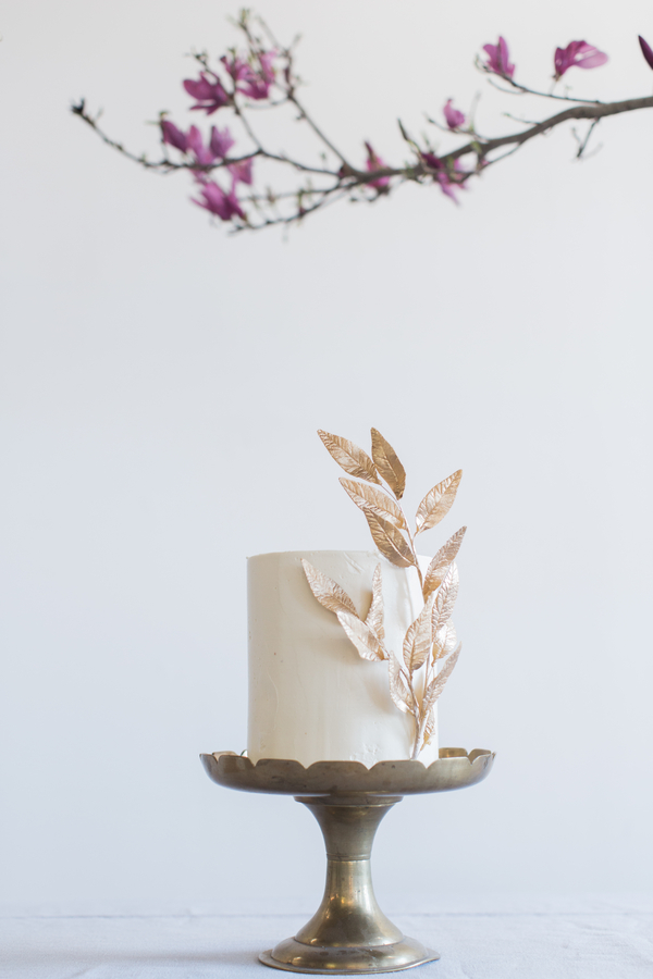 single tier wedding cake with gold leaf