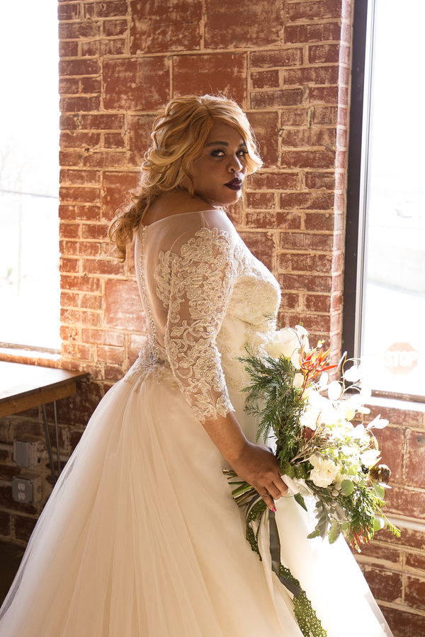 Bride wearing long sleeved lace gown