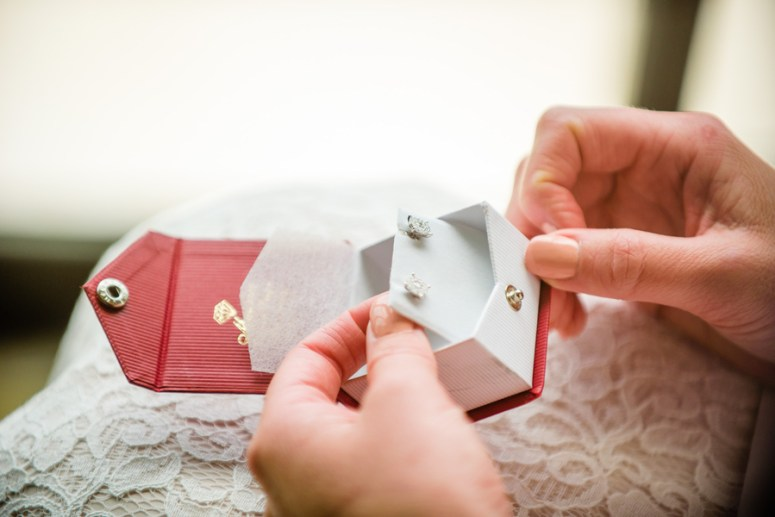 Bride Opening Gift from Groom on Wedding Day