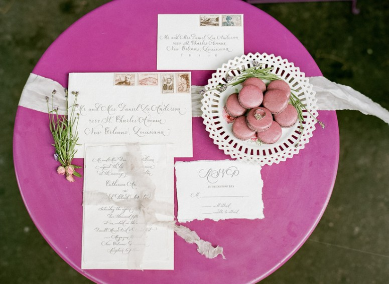 A pink parisian themed intimate cafe wedding so this is love pink macaroons with pink wedding invitations junglespirit Images