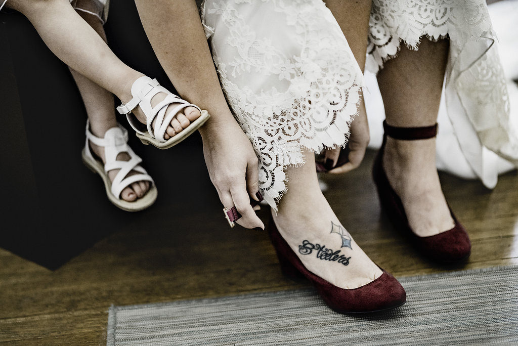 unique wedding shoes, bride with tattoos
