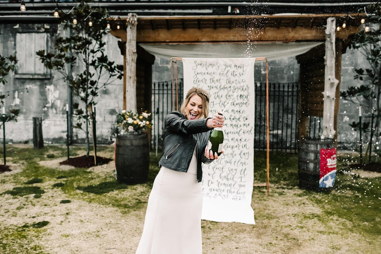 Loflin Yard Wedding, Memphis Wedding, Rock and Roll Bride, Modern Wedding, bride popping champagne bottle