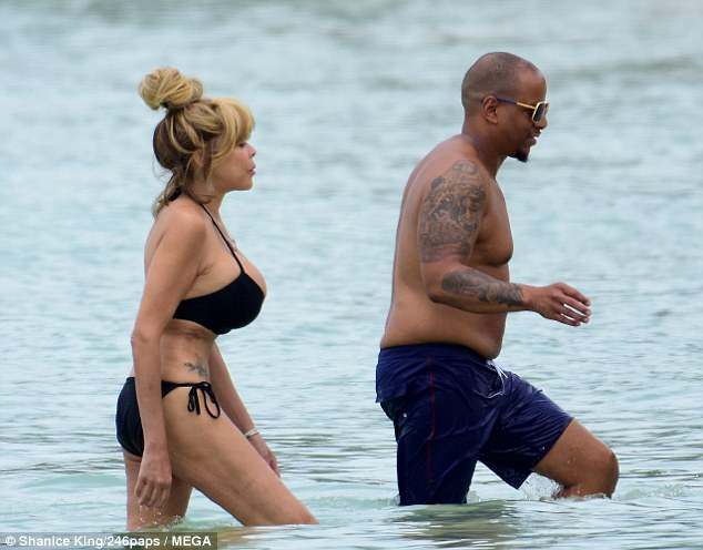 Her man: Her husband of 20 years, Kevin Hunter, joined Wendy on the white sands, as they enjoyed some alone time without their 17-year-old son, Kevin Jr