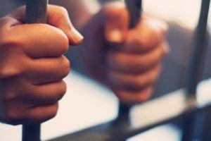 hands on prison bars