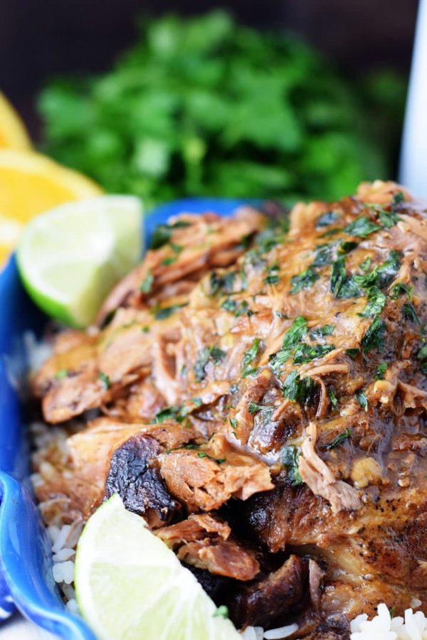 Cuban Mojo Pork Roast topped with thicken marinade gravy and parsley