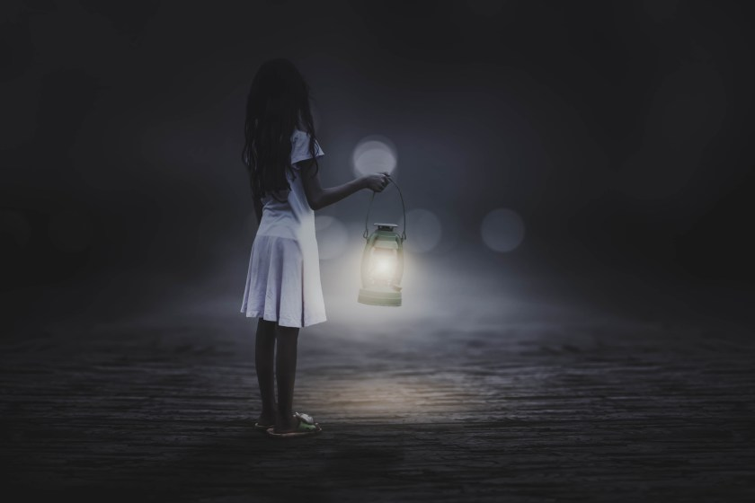 Looking for the road using a lantern