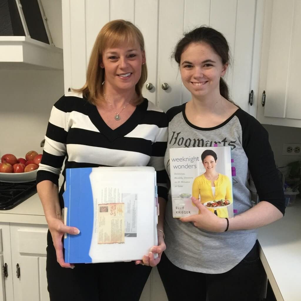 """Melissa with the """"ginormous"""" binder and Sarah with Ellie Krieger's Weeknight Wonders Cookbook"""