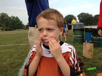 Melissa's son eating a donut after soccer
