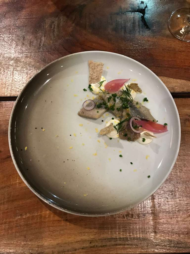 Pickled herring, sour cream, dill, onions, butter and egg