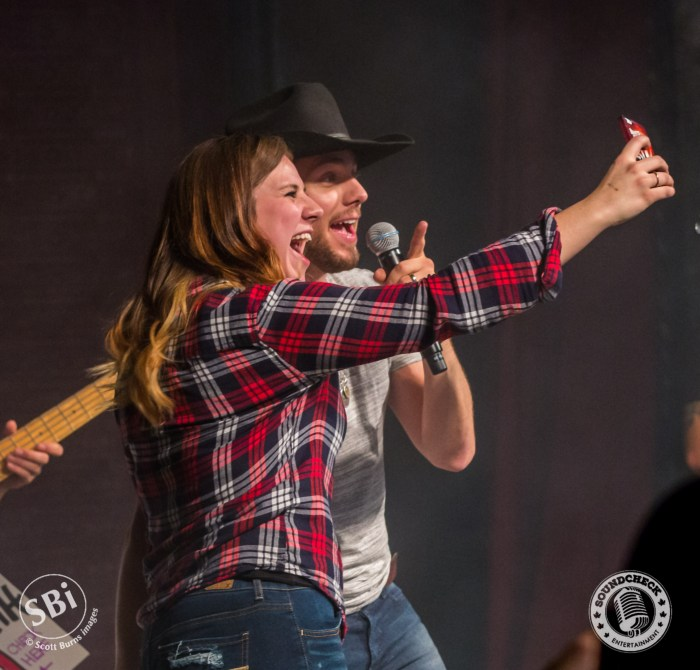 Brett Kissel makes a young girl VERY HAPPY at The Roxy Theatre in Barrie on the Airwaves Tour: Photo Scott Burns