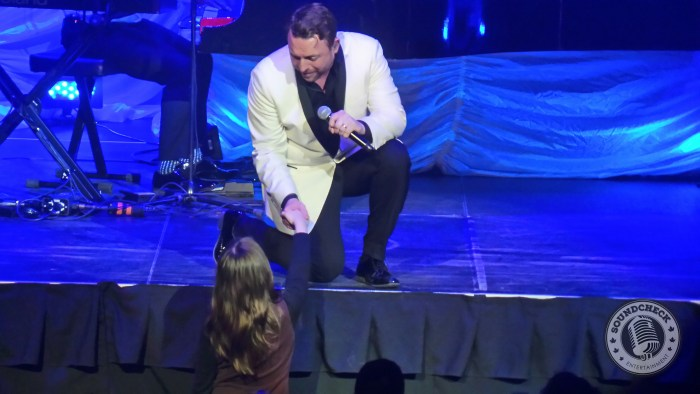 Johnny Reid sings to a fan at TD Place in Ottawa March 26, 2016