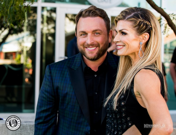Johnny Reid and his wife walking the John Deere Green Carpet at the 2016 CCMA Awards - Photo: Bill Woodcock