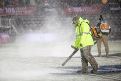 Clearing the snow at the 105th Grey Cup in Ottawa photo by Renee Doiron