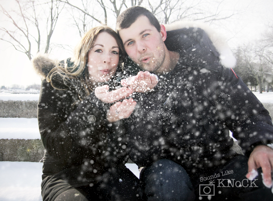 winter engagement photo blowing snow by ngoc nguyen