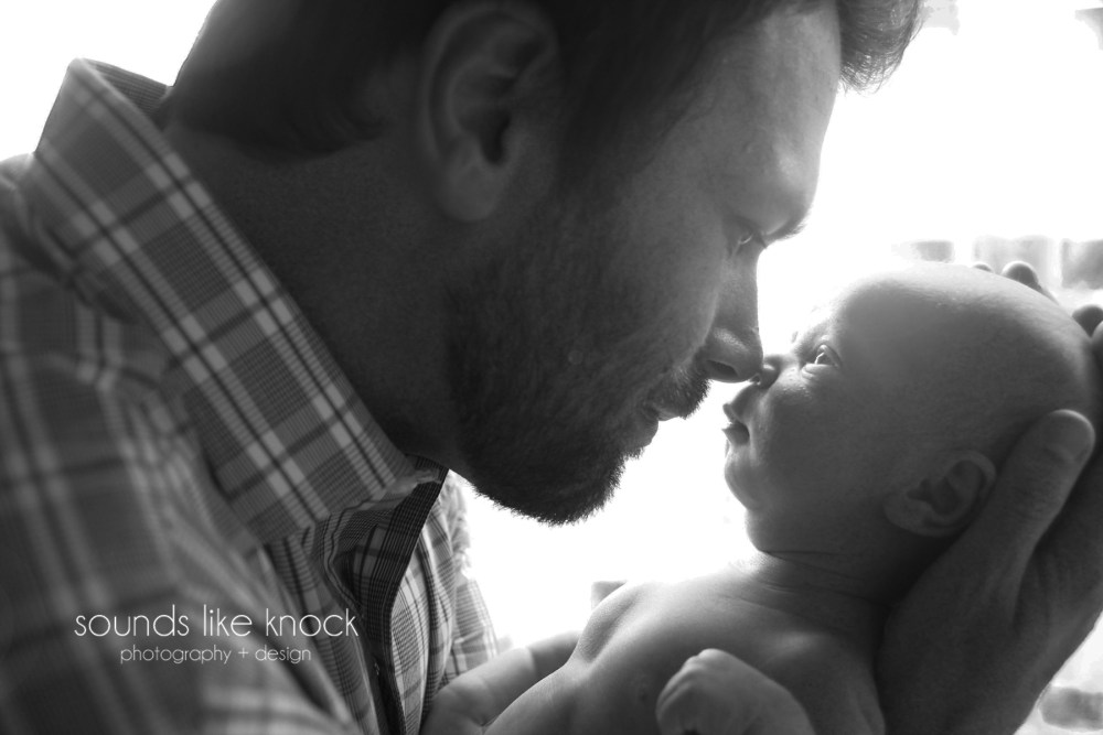 newborn and father moment