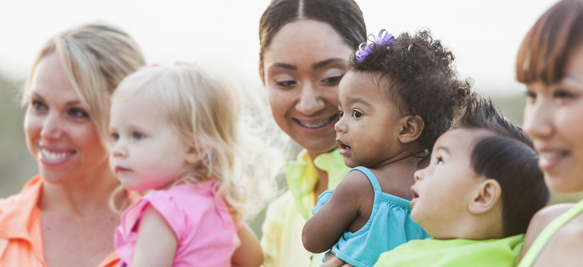 Multi-racial moms and babies, focus on black baby girl