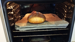 Photo of baked loaf on the home made stone in the oven at the Devonport Fly Fishing Lodge.