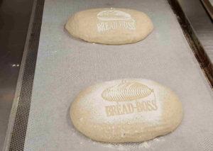 Bread Boss logo on dough