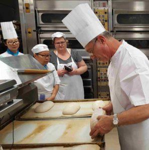 Preparing dough on peel and slashing before baking.