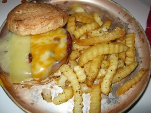 <p>Turkey Burger Served on Cinnamon Roll with Swiss, Colby Jack, and Cheddar Cheese</p>