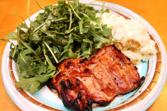 Plated for dinner: Grilled chicken with arugula and potato salad.