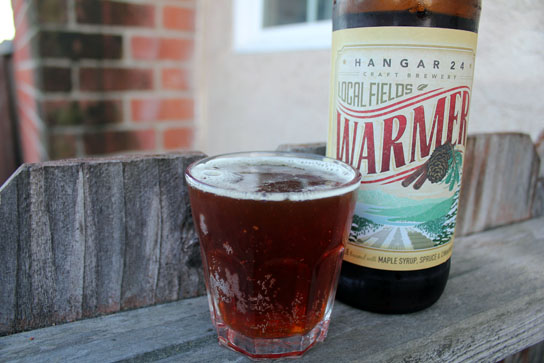 Warmer strong ale, from Hangat 24, is brewed with fresh spruce, maple syrup, and spices.